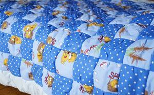 Изображение Детское одеяло ручной работы в стиле печворк